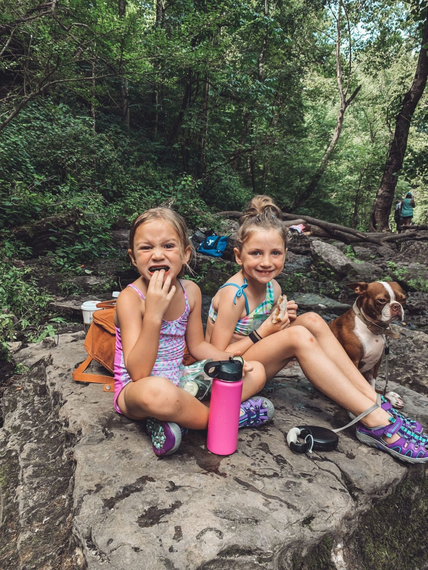 Family-Friendly Waterfall Hiking Trails in Nashville, TN by popular Nashville blog, Modern Day Moguls: image of a two girl and a dog eating lunch at Rutledge Falls in Tullahoma, TN.