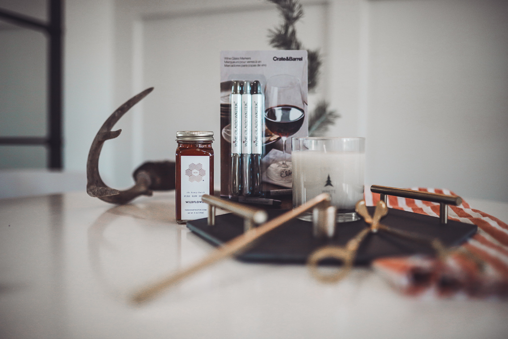Luxury Trapp Candles Create Hygge This Holiday Season by popular Nashville lifestyle blog, Modern Day Moguls: image of a some decorating supplies next to a Trapp candle.