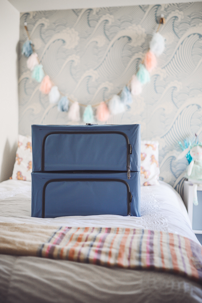 How to Organize Kids Closets Seasonally by popular lifestyle blog, Modern Day Moguls: image of some Stack & Store – Collapsible 44 Liter Soft Storage Boxes on a bed.