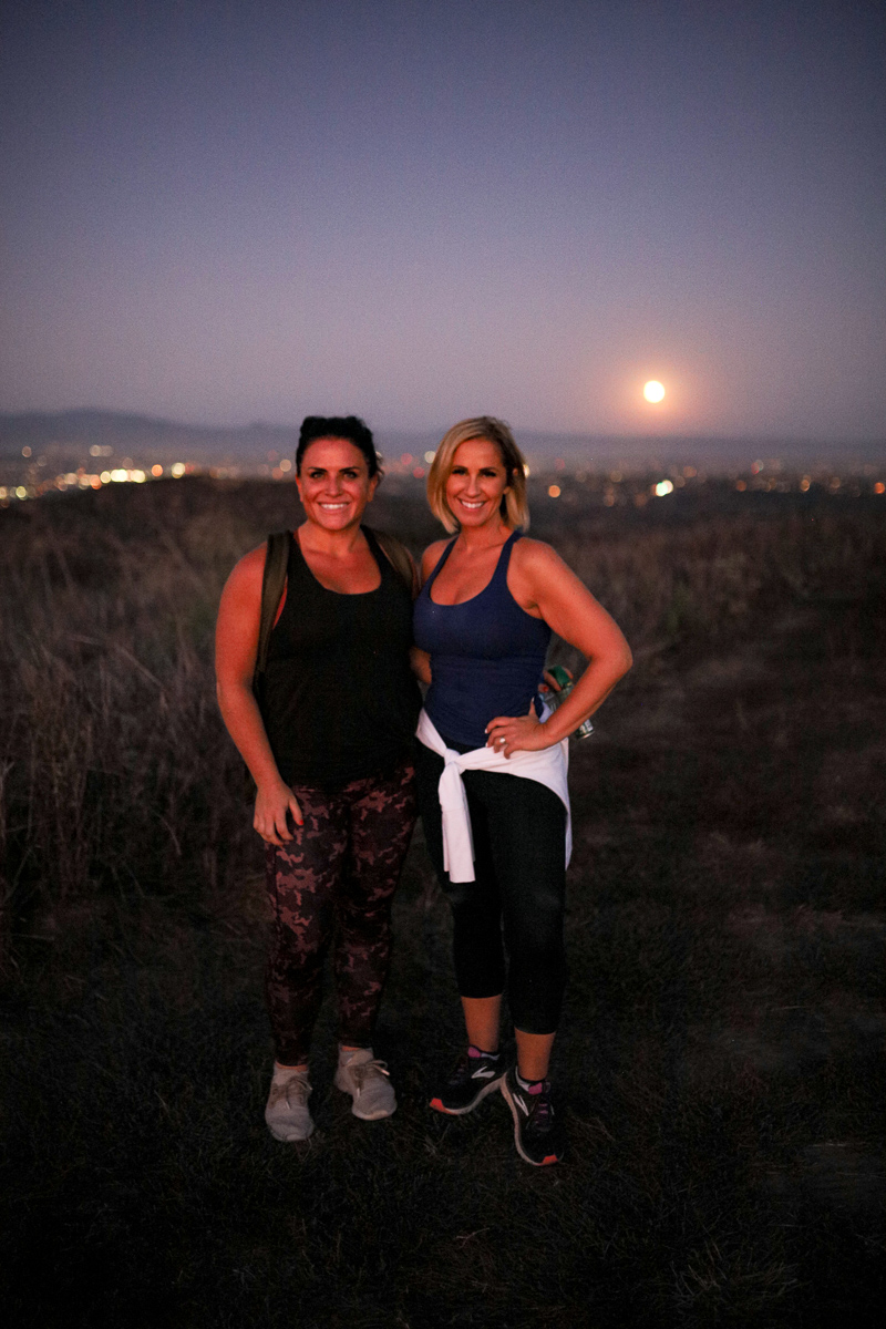 California Vacation Ideas for a Momcation in Orange County by popular Nashville travel blog, Modern Day Moguls: image of two woman on a hiking trail.