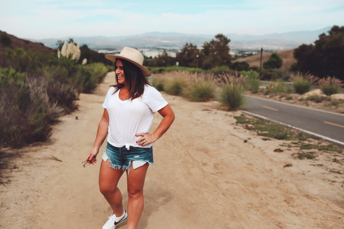 California Vacation Ideas for a Momcation in Orange County by popular Nashville travel blog, Modern Day Moguls: image of a woman standing by the side of a road.