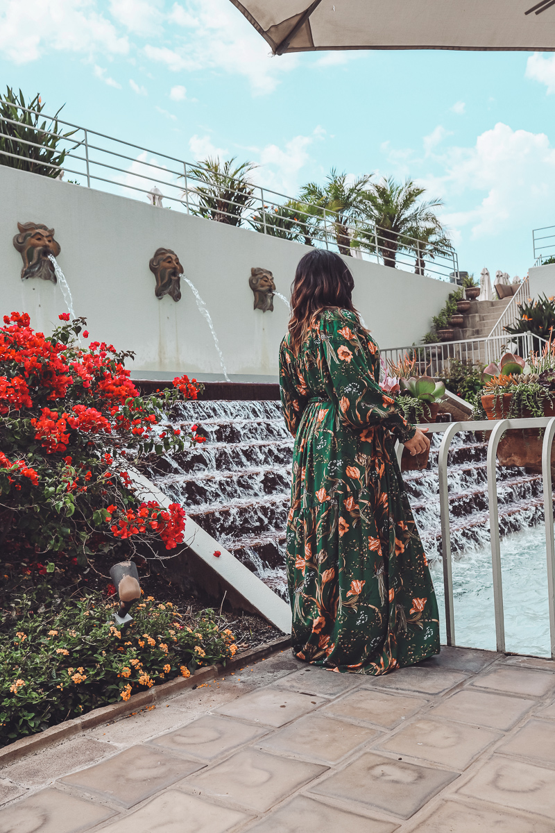 California Vacation Ideas for a Momcation in Orange County by popular Nashville travel blog, Modern Day Moguls: image of a woman standing outside at the Westin South Coast Plaza.