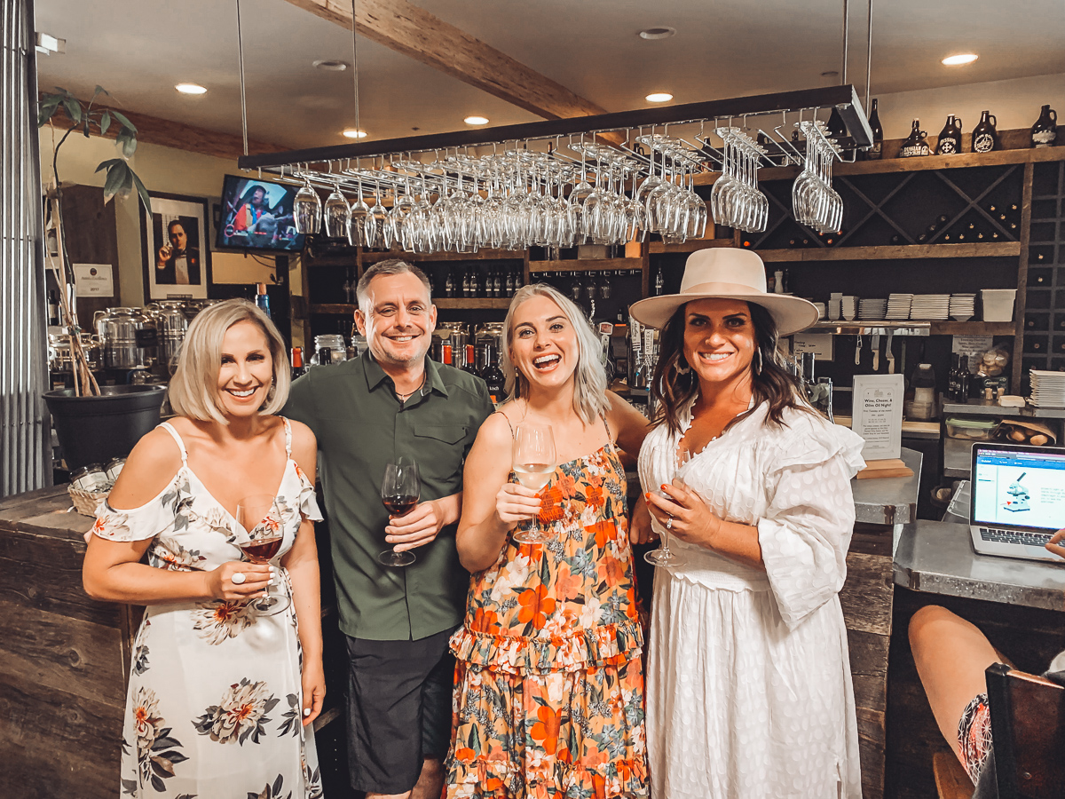 California Vacation Ideas for a Momcation in Orange County by popular Nashville travel blog, Modern Day Moguls: image of people standing together inside We Olive.