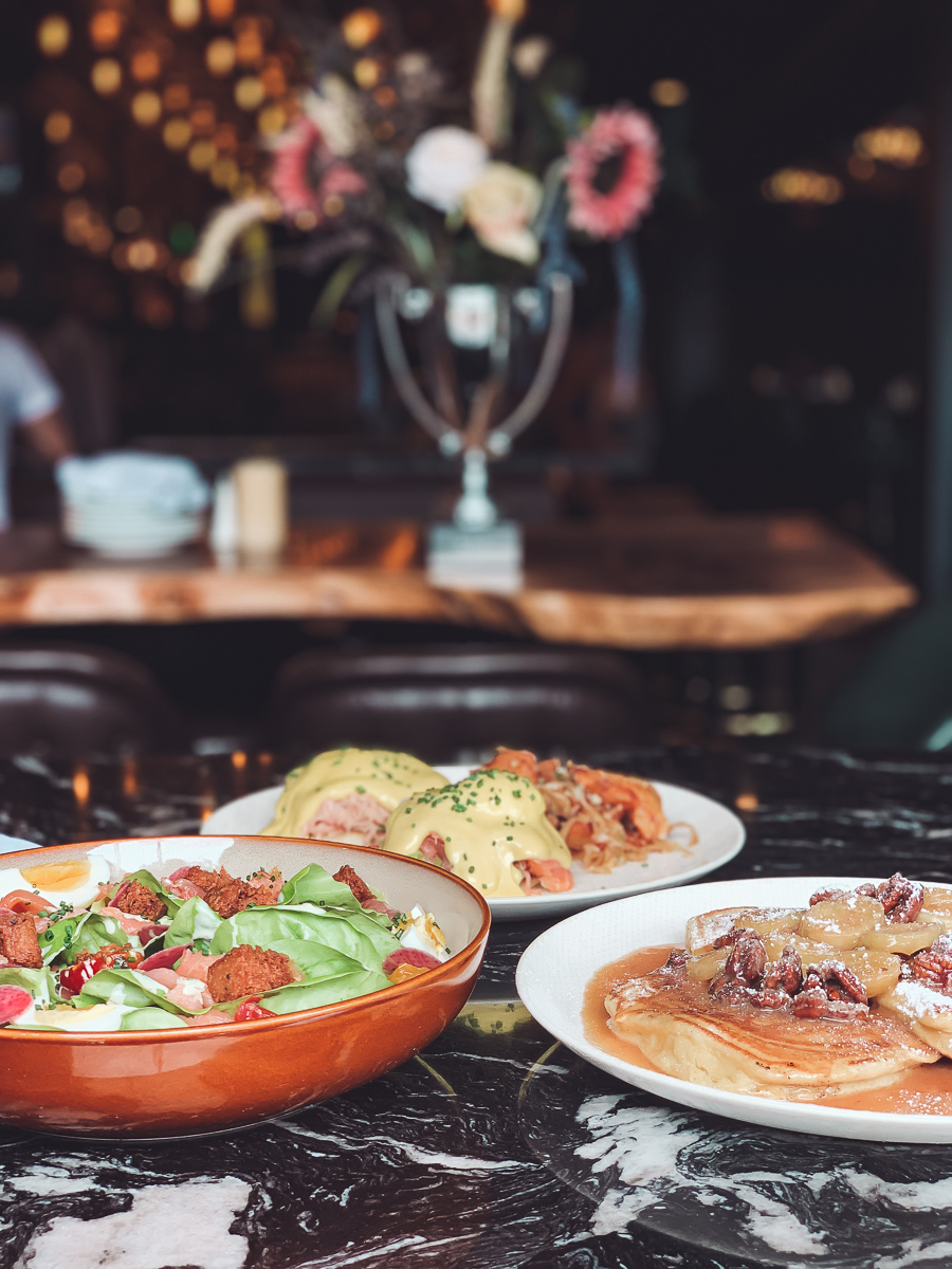 California Vacation Ideas for a Momcation in Orange County by popular Nashville travel blog, Modern Day Moguls: image of a salad, pancakes, and eggs Benedict.