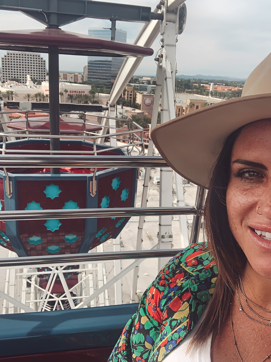 California Vacation Ideas for a Momcation in Orange County by popular Nashville travel blog, Modern Day Moguls: image of a woman riding on a ferris wheel.