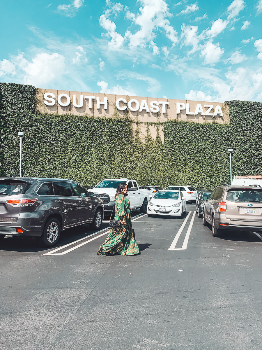California Vacation Ideas for a Momcation in Orange County by popular Nashville travel blog, Modern Day Moguls: image of a woman outside of the South Coast Plaza.