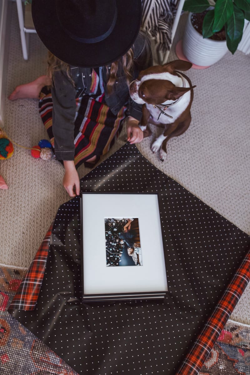 Picture Frames: Gift Ideas From a Child by popular Nashville life and style blog, Modern Day Moguls: image of a girl wrapping some pictures frames.