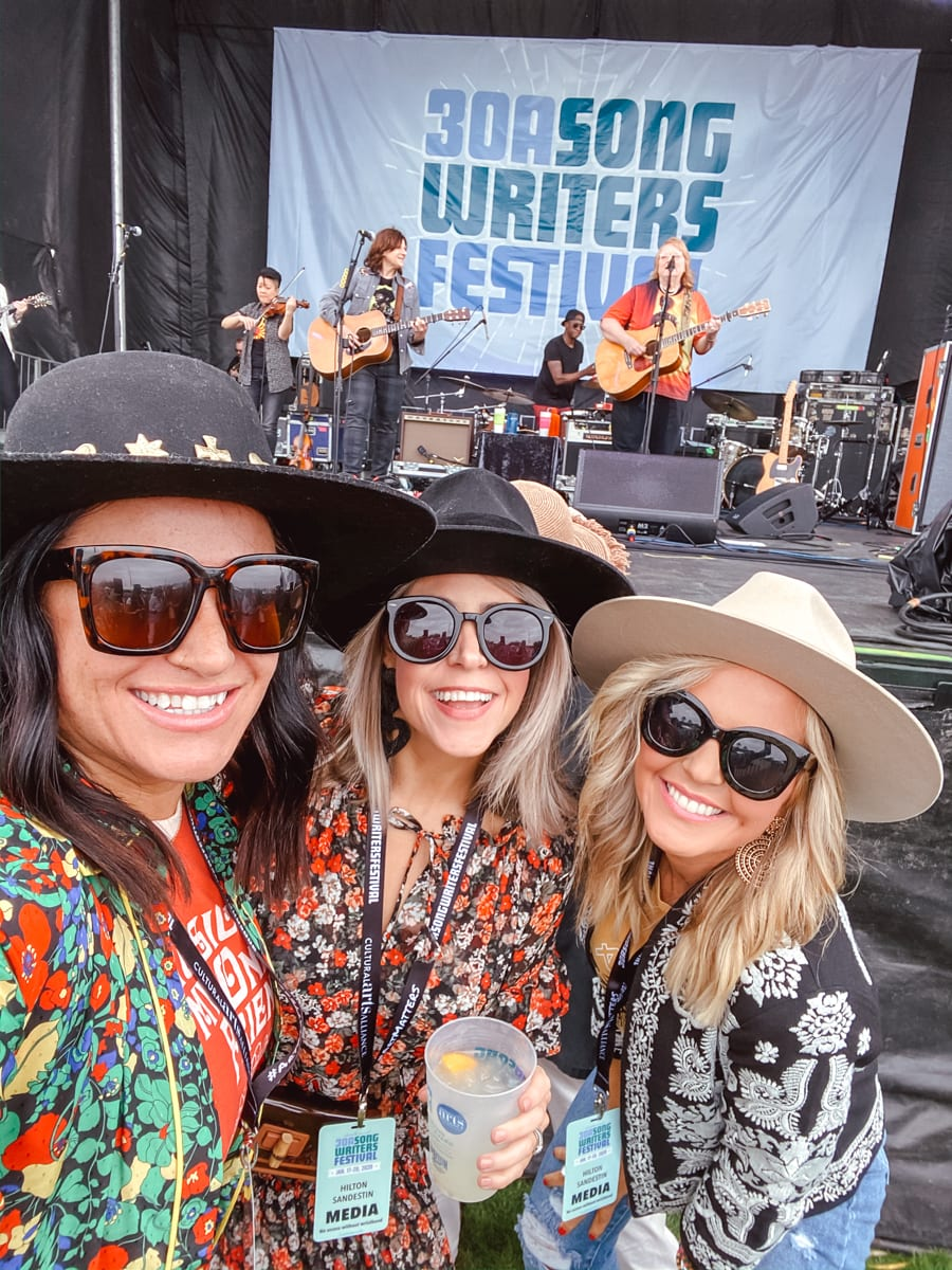 30a Songwriters Festival by popular Nashville life and style blog, Modern Day Moguls: image of a group of girls sitting in the front row at the 30a Songwriters Festival.
