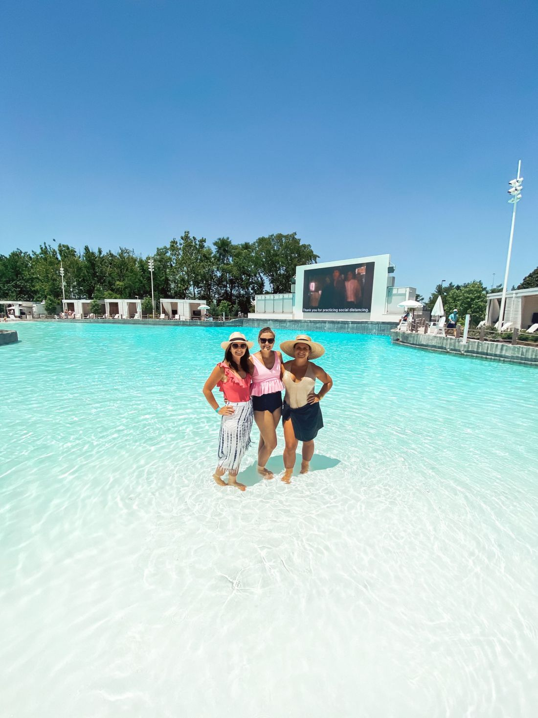 Soundwaves Water Park by popular Nashville blog, Modern Day Moguls: image of three women standing together in the shallow end of a pool.