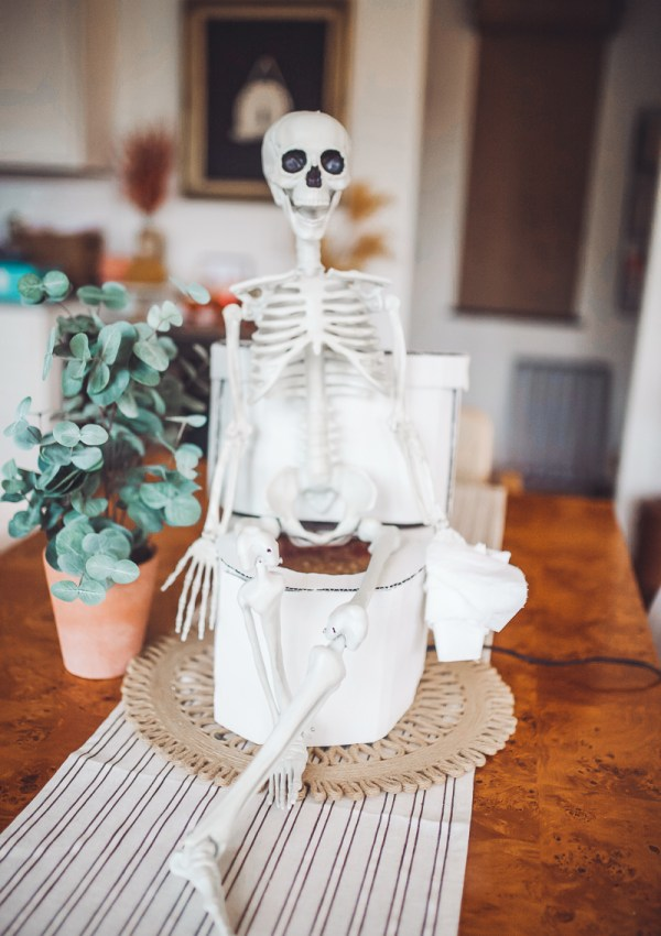 Safe Halloween by popular Nashville lifestyle blog, Modern Day Moguls: image of skeleton table centerpieces.