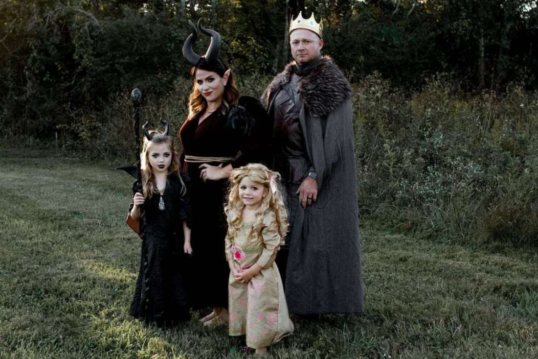 Safe Halloween by popular Nashville lifestyle blog, Modern Day Moguls: image of a family wearing Maleficent costumes, a king costume, and a sleeping beauty costume.