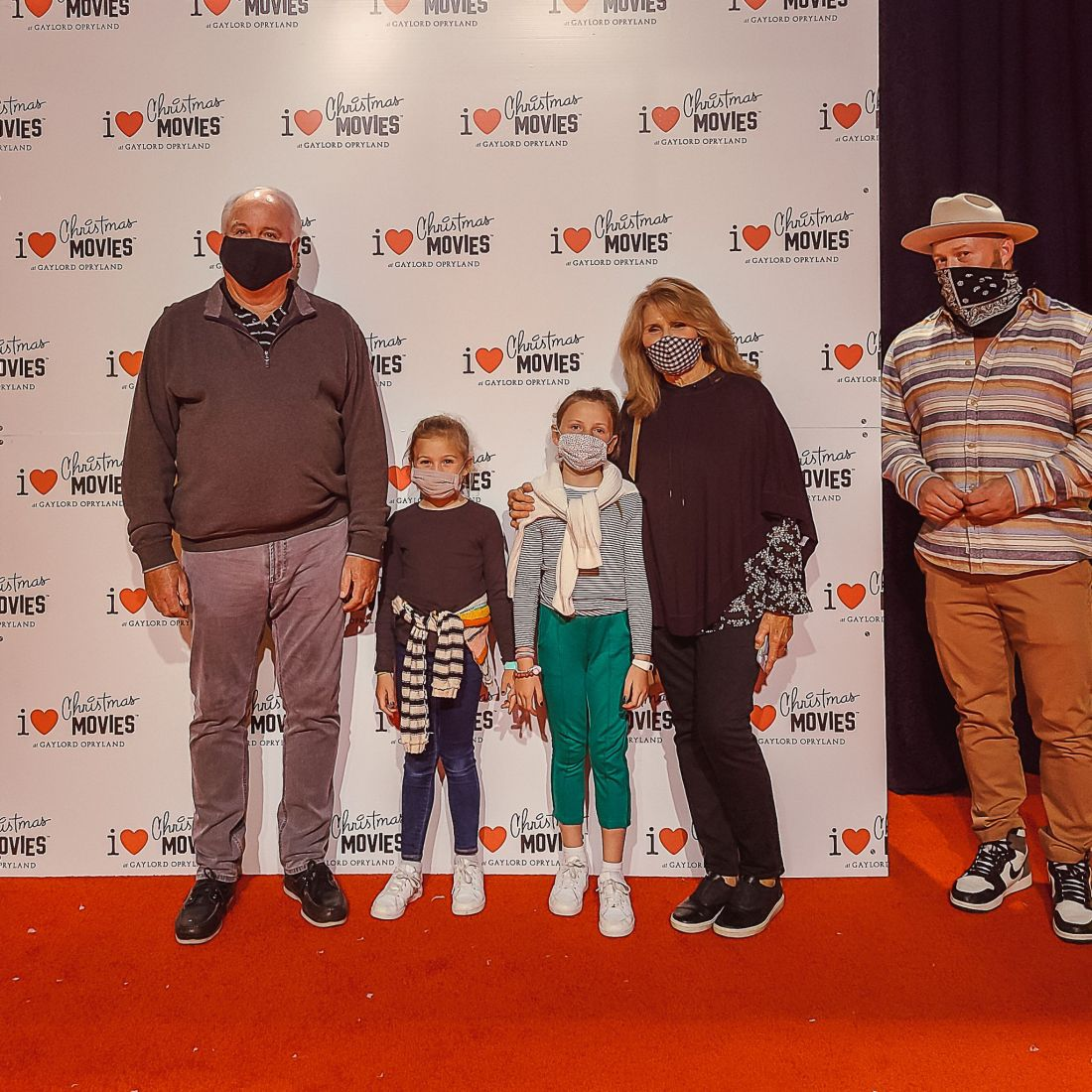 Gaylord Opryland Christmas by popular Nashville blog, Modern Day Moguls: image of two girls standing with their grandparents and their dad for a red carpet I love Christmas Movies picture.