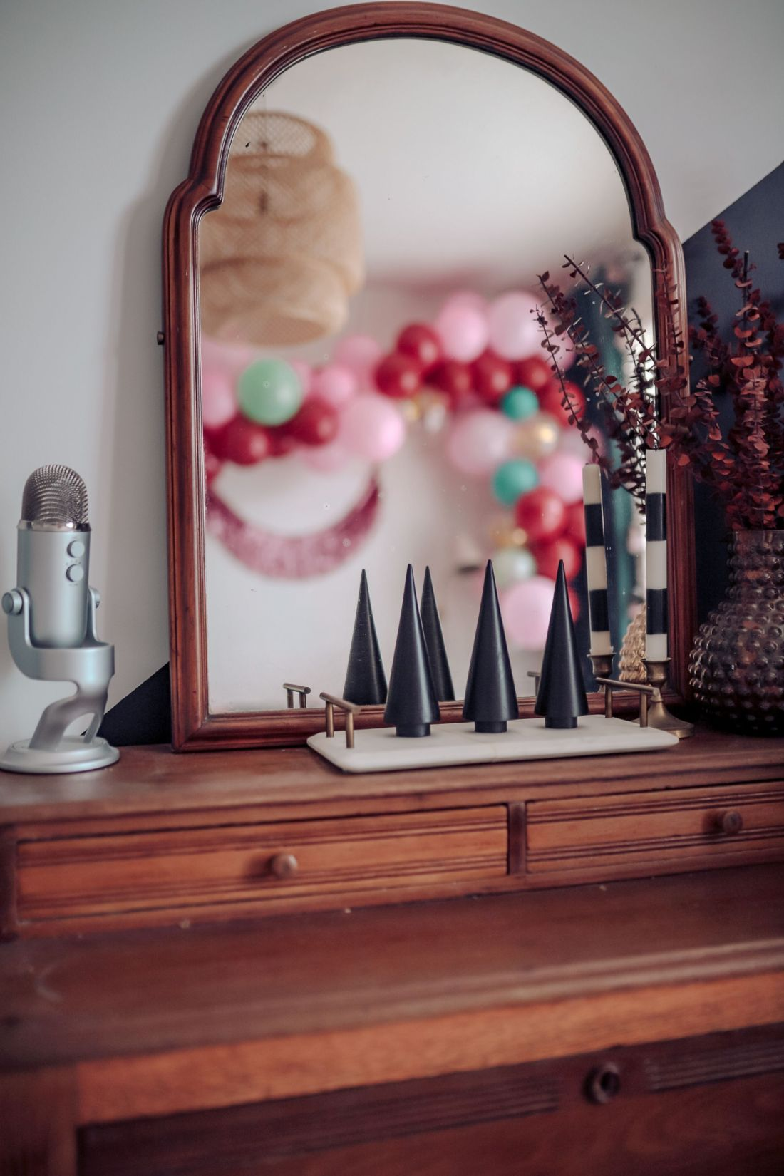 Carpet and Rug Institute by popular Nashville life and style blog, Modern Day Moguls: image of a wooden dresser decorated with a microphone, mirror, and marble and brass handle tray containing modern black Christmas tree decor.