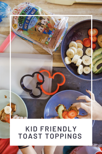 Kid Friendly Meal Ideas by popular Nashville lifestyle blog, Modern Day Moguls: Pinterest image of a red Mickey Mouse sandwich cutter, a bowl full of cut up bananas, strawberries, and avocado, and a loaf of Arnold Organic white bread.