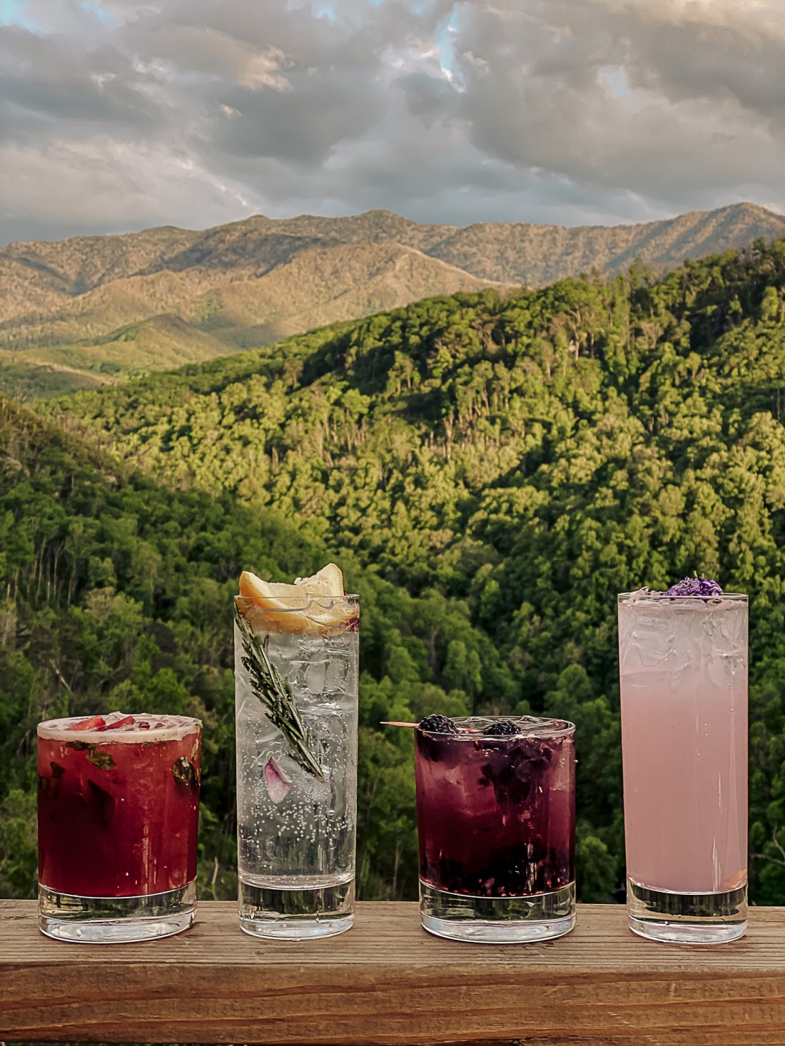 Gatlinburg Tennessee by popular Nashville travel blog, Modern Day Moguls: image of cocktail drinks  with the Smokey Mountains in the background.