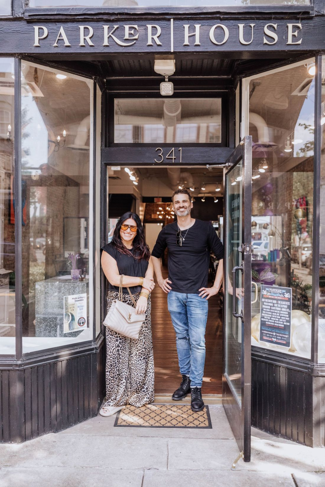 Hair Cut by popular Nashville beauty blog, Modern Day Moguls: image of a woman and a man standing together in the entrance of Parker House Salon.