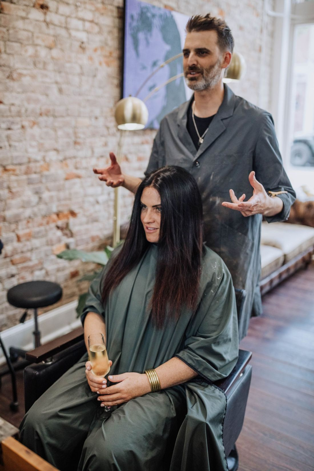 Hair Cut by popular Nashville beauty blog, Modern Day Moguls: image of a woman sitting in a salon chair at Parker House Salon and getting her hair done by a man.