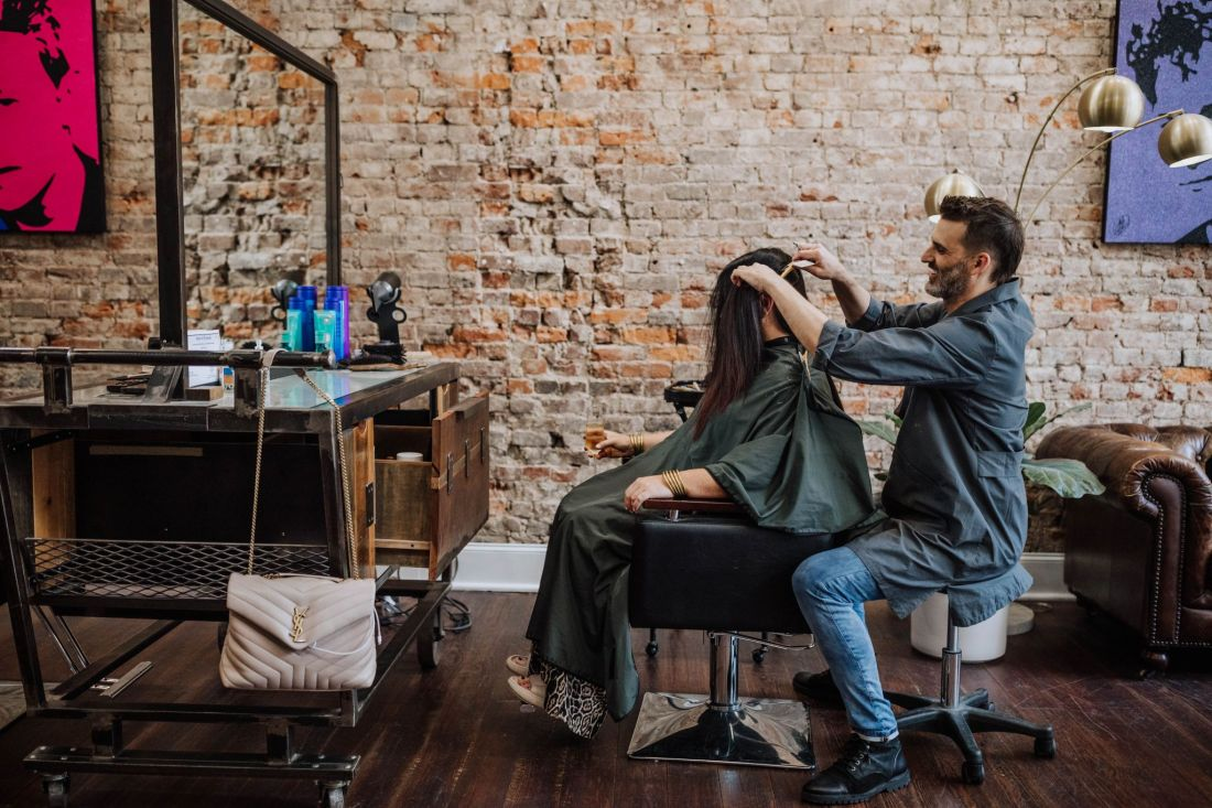Hair Cut by popular Nashville beauty blog, Modern Day Moguls: image of a man cutting a woman's hair at Parker House Salon.