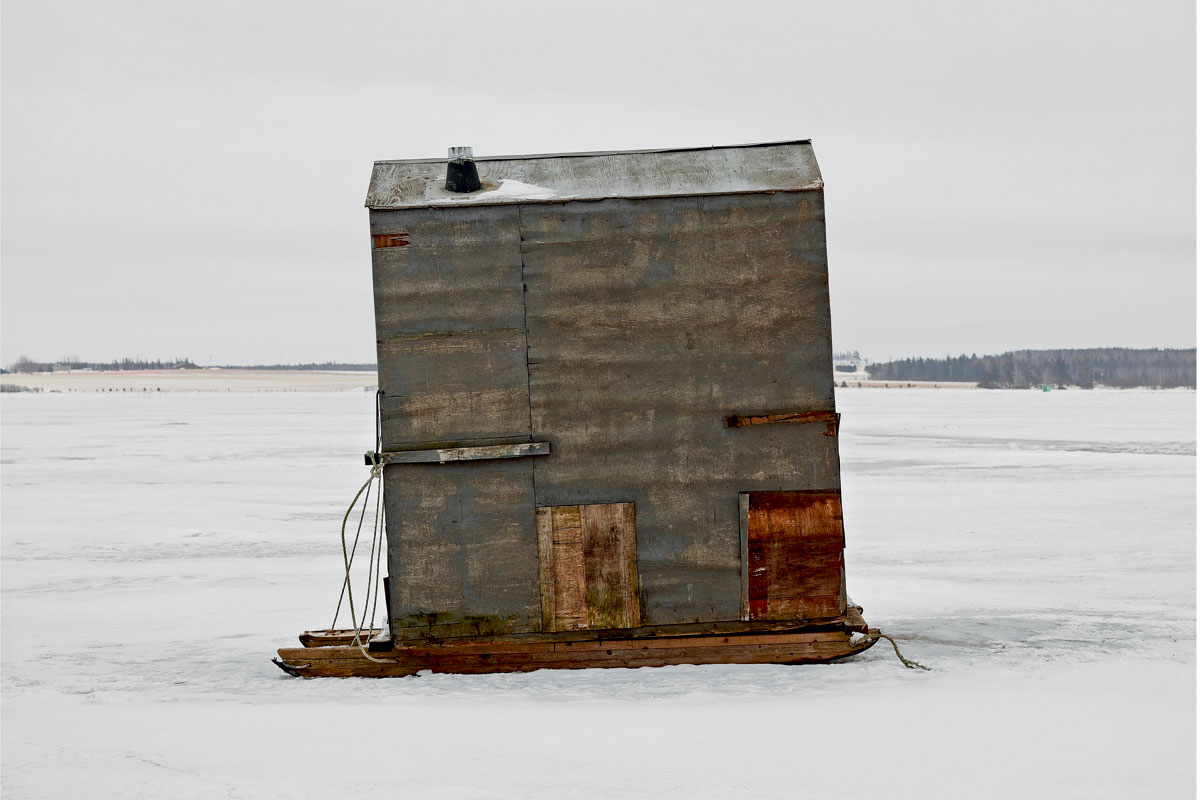 ice fishing lawn chair canadian tire deck covers photo essay portraits of canada s huts modern farmer prince edward island windowless dot the 1 100 miles coastline allowing spearfishermen a clear view their prey beneath