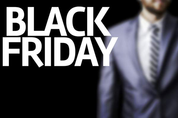 Business man with the text Happy Black Friday in a concept image