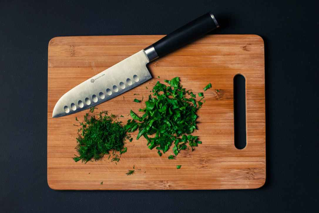 food-vegetables-wood-knife herbs chopped