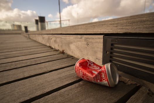Litter cola can crunched on ship dock