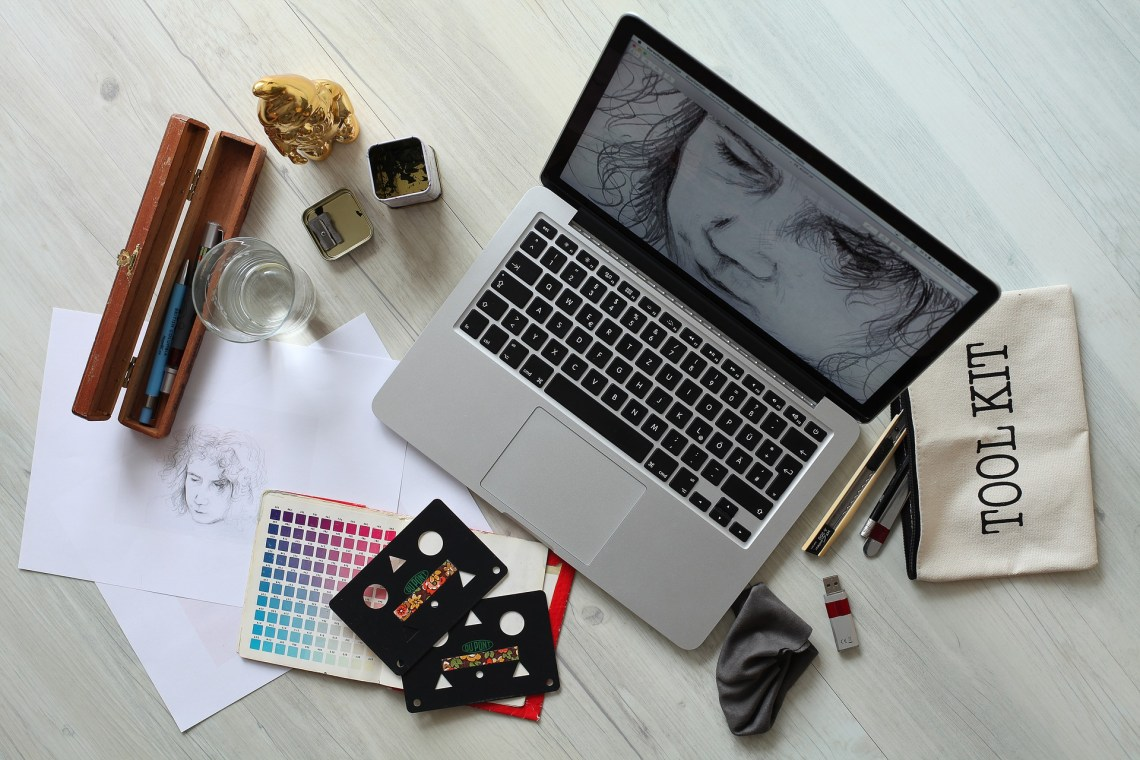 a day in the life of a graphic designer, drawing digital graphics, hand painting