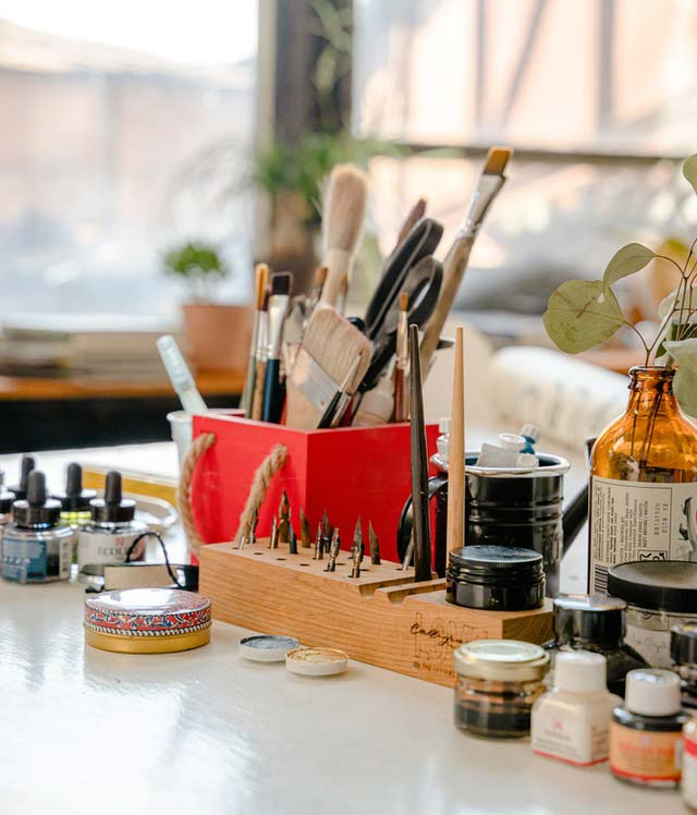 set up your art table and organize your paint brushes and inks to help you succeed at the 100 day project