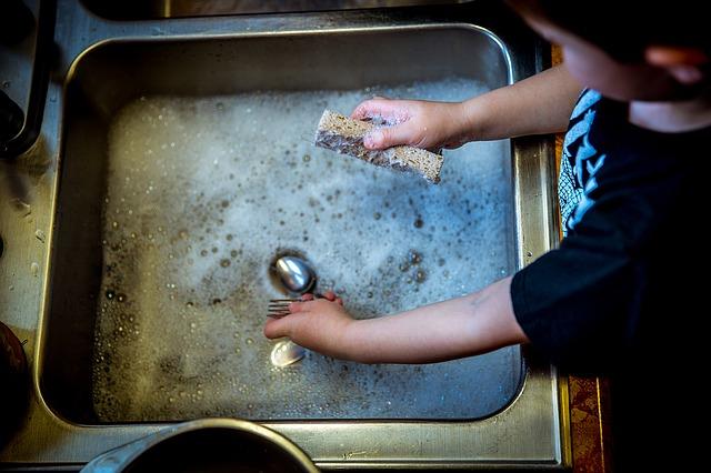 Child washing dishes