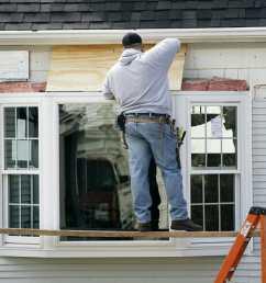 a contractor installs a bay window into a home [ 1000 x 869 Pixel ]