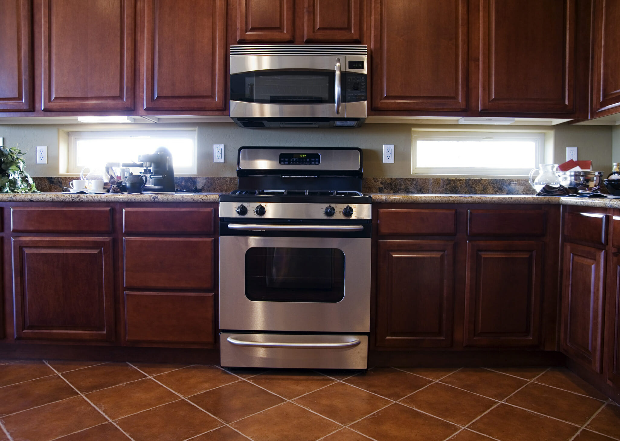 mahogany kitchen cabinets wallpaper backsplash modernize