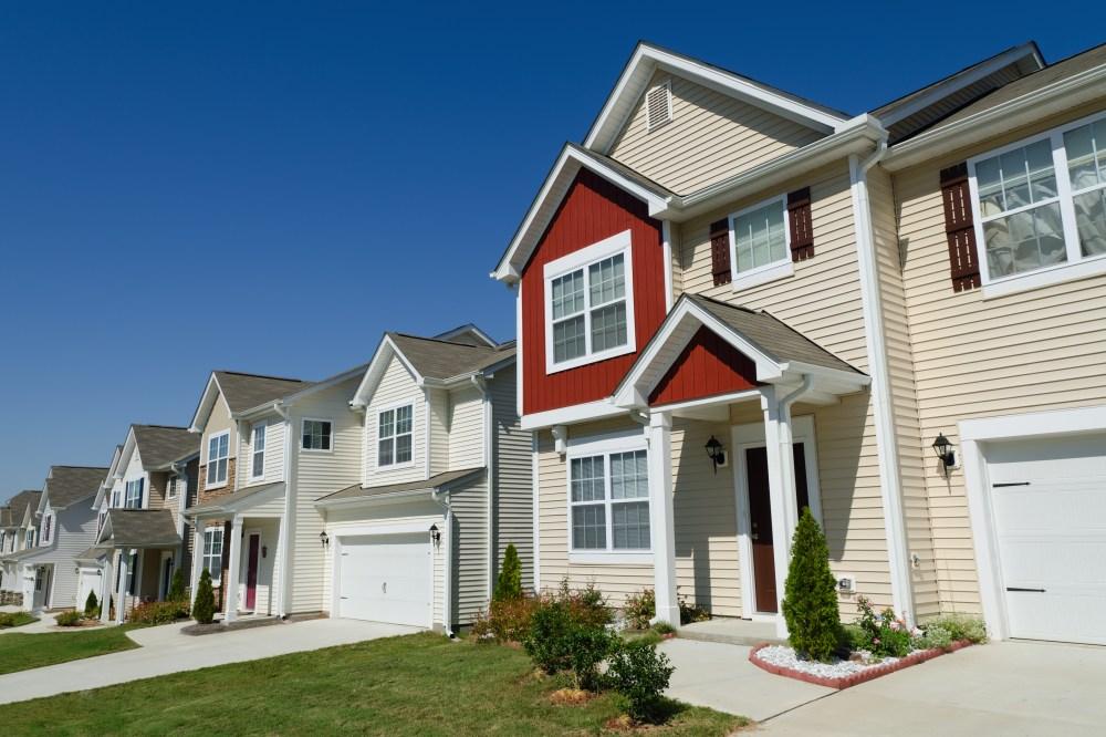 medium resolution of home with multicolored vinyl siding