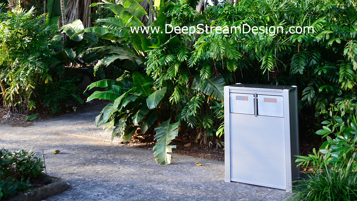 Oahu Modern RPL Wood Combination Trash and Recycling Bin in a tropical rainforest arboretum