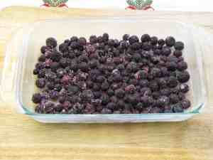 Place blueberries in bottom of greased casserole dish.