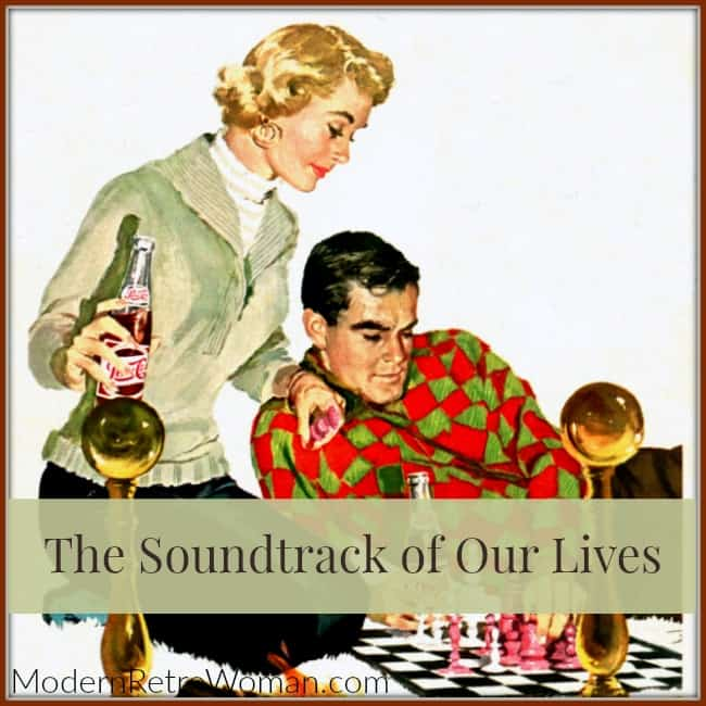 Man and woman relaxing by fire listening to music and playing chess for The Soundtrack of Our Lives post on ModernRetroWoman.com 650x650