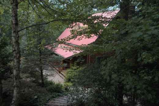 This Barna Log Home is nestled among the hard wood trees and right on the Coosawattee River.
