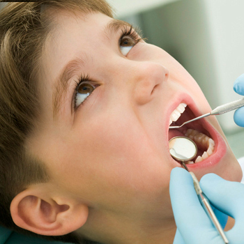 Picture of a young boy having a dental exam.