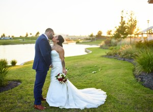 red lakeside wedding