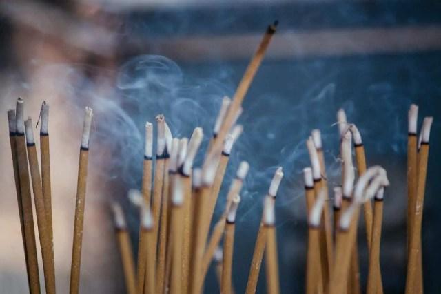 multiple incense sticks | Photo by Milada Vigerova