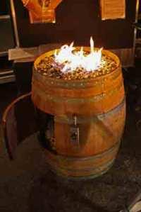 Convert a wine barrel into a safe outdoor firepit.