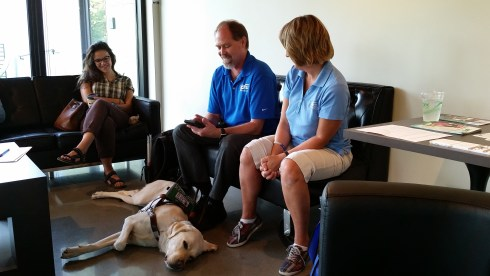 Doug Wampler and his service dog, and Lisa Kelly from Outlook Nebraska, Inc.