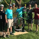 group with bike and dog