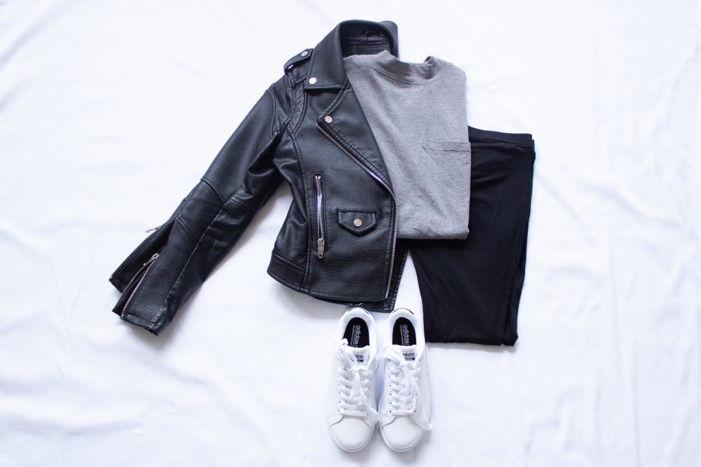 moto jacket with t shirt, leggings, and white sneakers