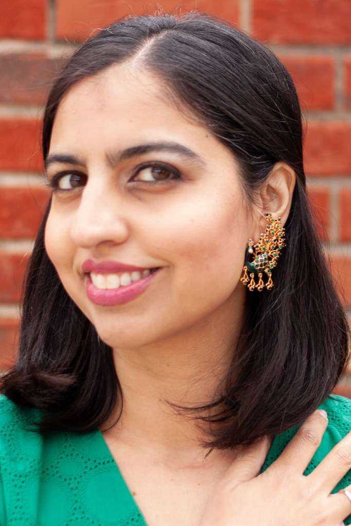 mixing ethnic pieces into your wardrobe peacock earrings