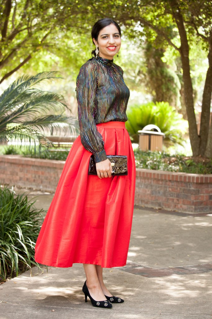 modest holiday outfit rainbow striped shirt and red skirt