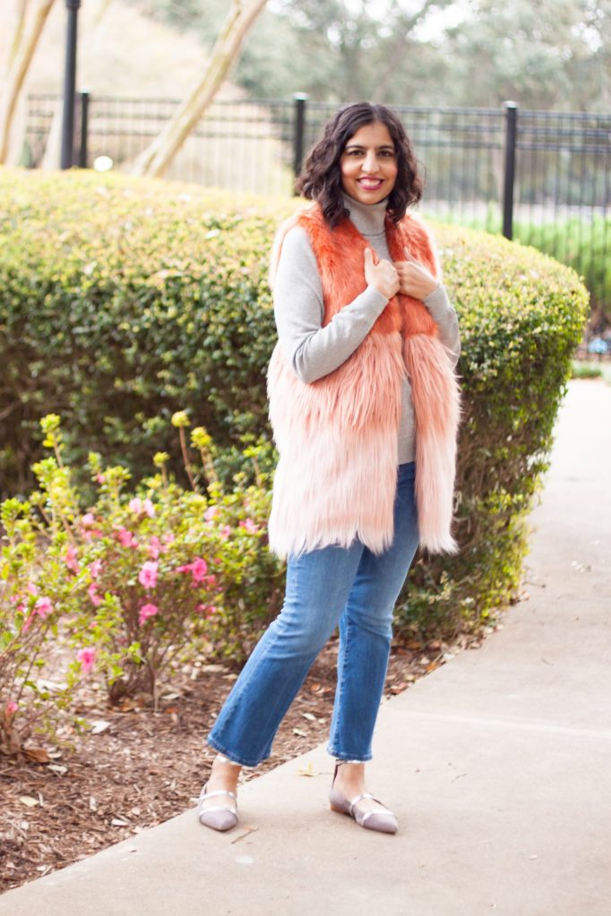 modest holiday party outfits, pink fur vest