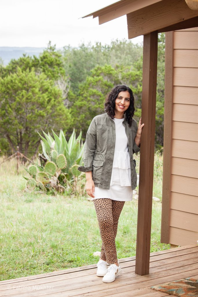 fall fashion idea utility jacket and cheetah print jeans with ruffled sweatshirt