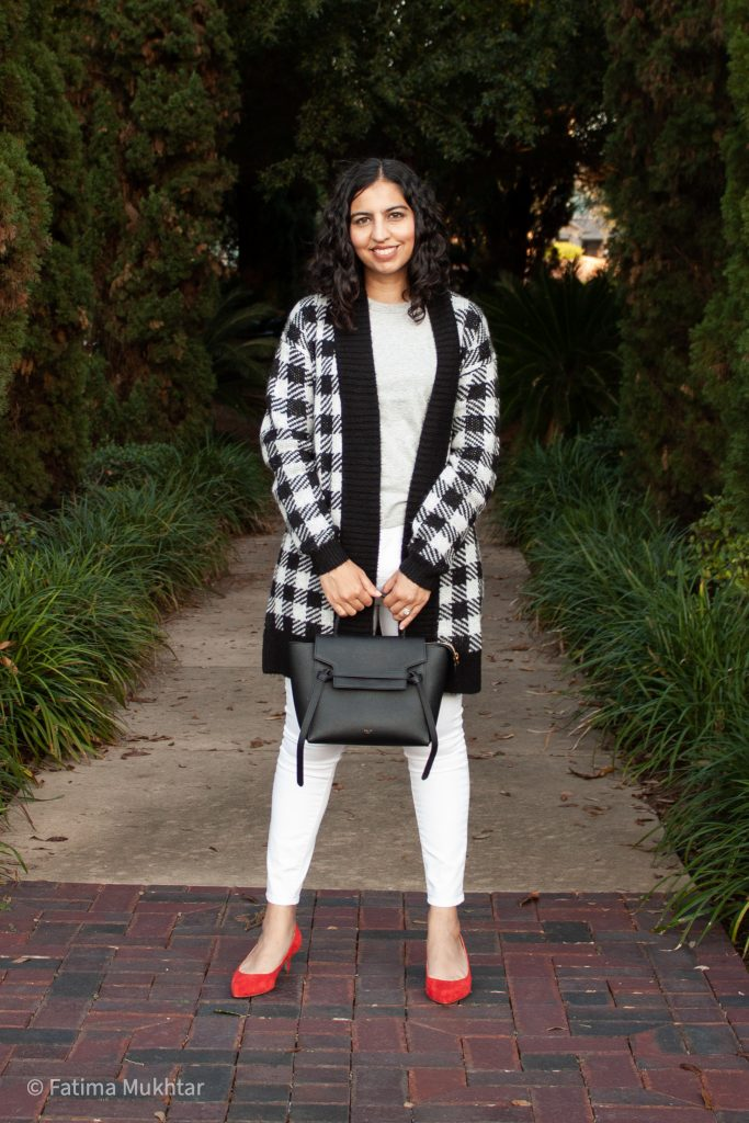 black and white buffalo plaid sweater, white jeans, and red pumps