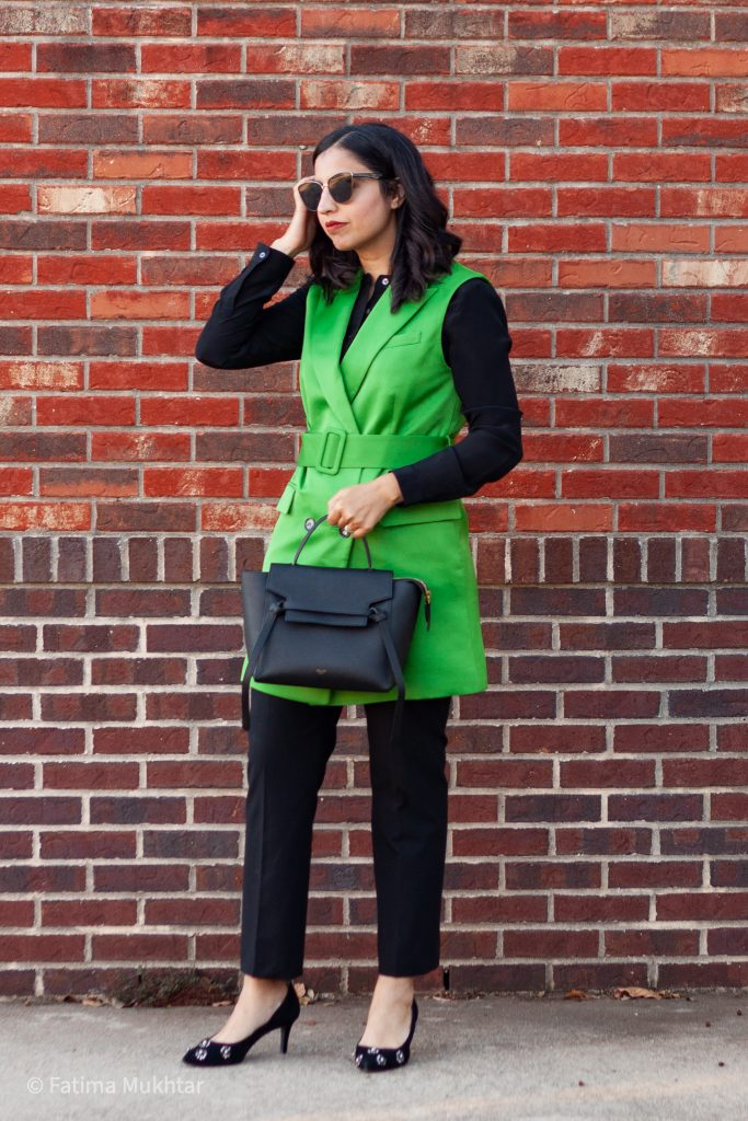 cute and modest work clothes green trench vest with black pants