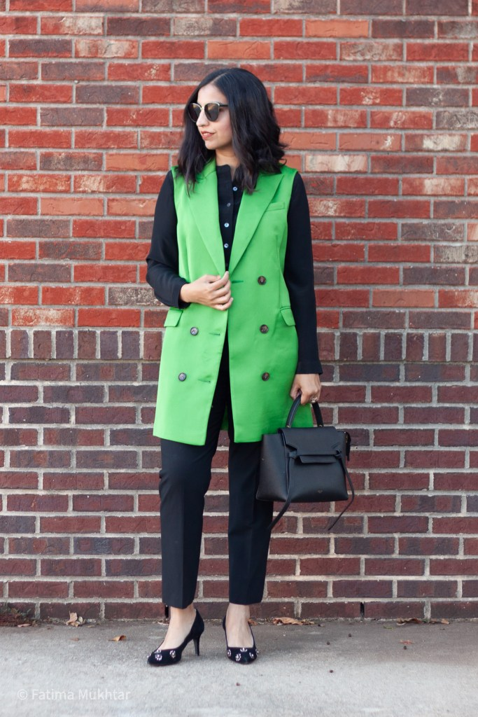 modest work outfit trench vest over black blouse and black pants